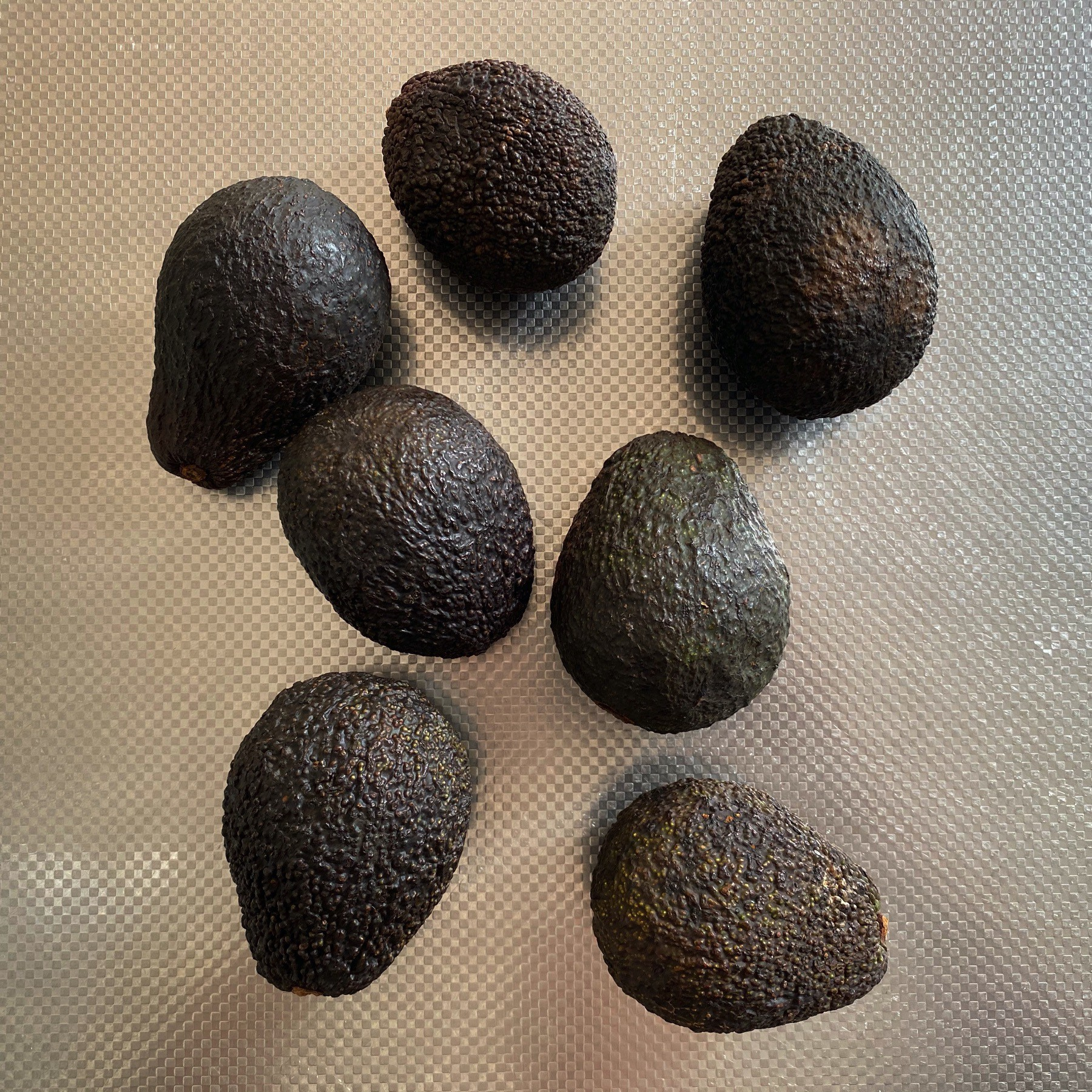 Seven Avocados Waiting To Be Eaten.